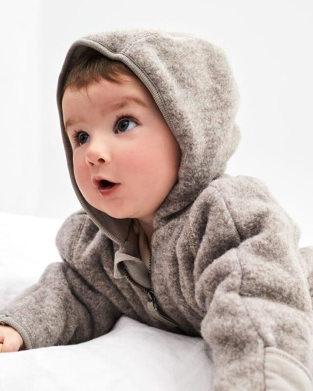 Baby wool fleece overalls made of organic merino wool in beige.