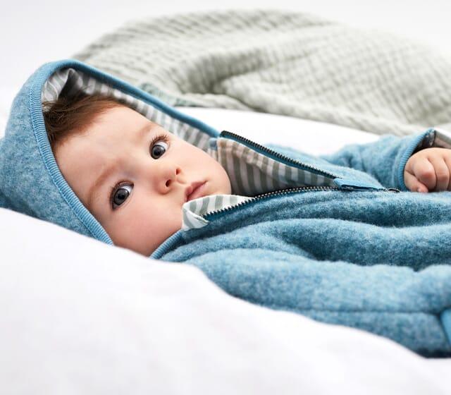 Baby wool fleece overalls made of organic merino wool in blue.