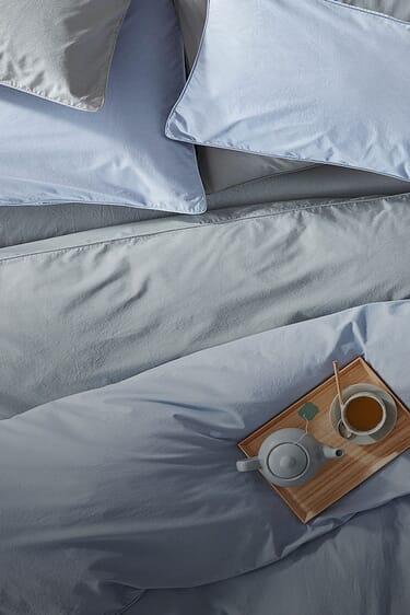 Nachhaltige Bettwäsche mit Hotelverschluss.